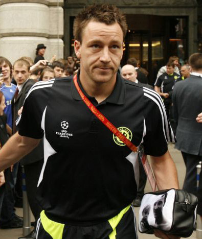 john terry holding a black and white wash bag