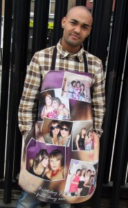 Man wearing apron covered with photos of girls