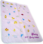 Baby changing mat with pink pattern and text