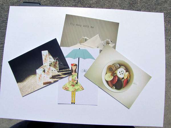 Four customised postcards