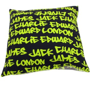 Black cushions with neon green graffiti words