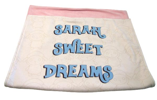 """Sarah sweet dreams"" written on white and pink blanket"