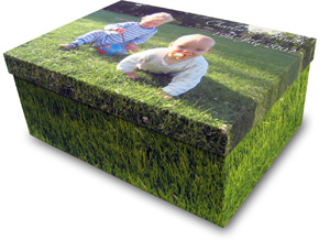 Two children on grass printed on a photo box