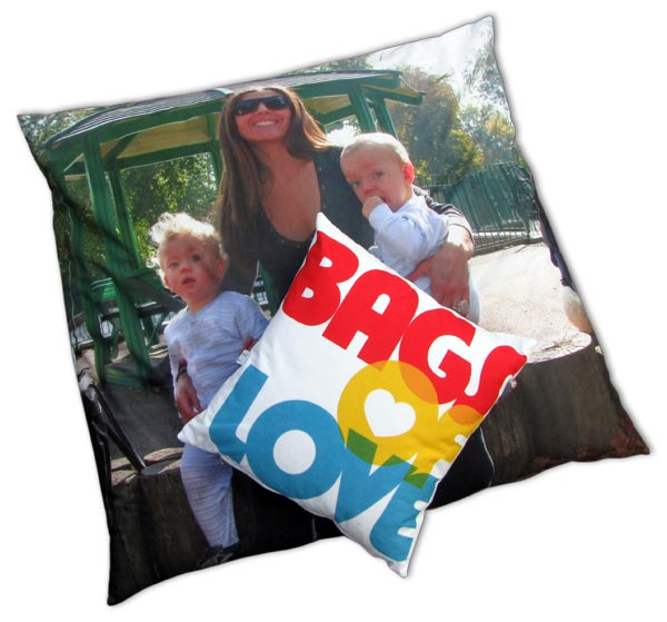 Mum with two kids on floor cushion and small cushion with bags of love written on it