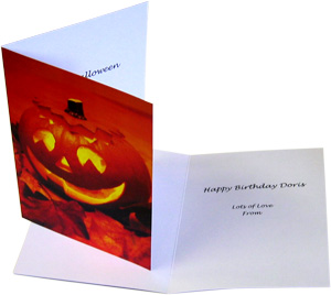 Greeting card with halloween image next to open greeting card with text