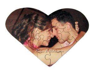 Man and woman hugging on heart shaped jigsaw puzzle
