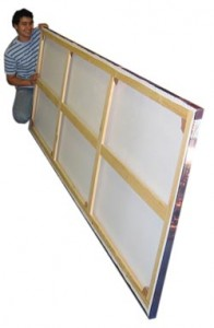 Man holding a large photo canvas printing