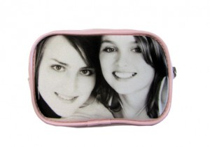Two girls in black and white on pink pouch purse