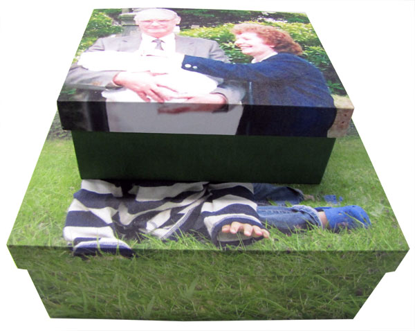 Old couple and baby on two photo boxes