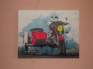 Two boys on a moped in Banksy Style artwork