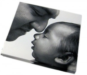 Black and white canvas print with a father and his baby on it