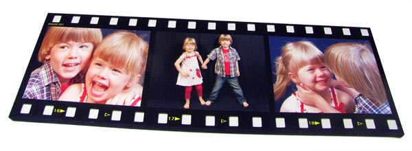Canvas print with filmstrip montage frame displayed two children