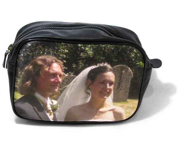 Man and women on their wedding day on a black leather wash bag