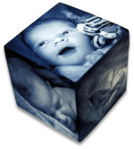 Balck and white photo cube with three baby photos on it