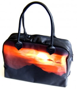 Black holdall bag with an orange sunset on it