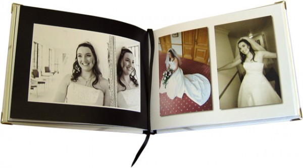 Open photo book displaying a woman on her wedding day