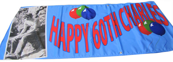 """Happy 60th Charlies"", photo and balloons printed on a banner"