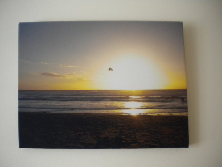 Sunset on a canvas print hanging on a wall