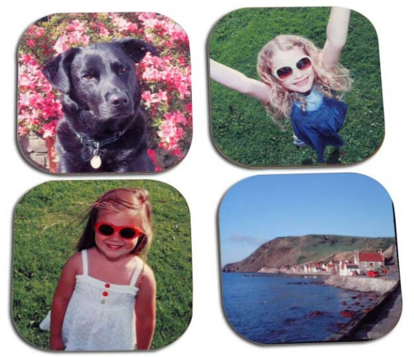 Two little girl, a dog and houses on the coast on four coasters