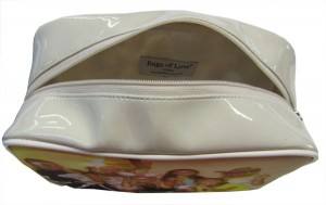 Zipped open beige make-up bag with a photo on the front