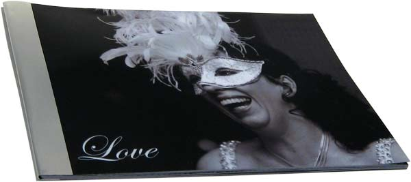 Woman with a mask on in black and white on a love book