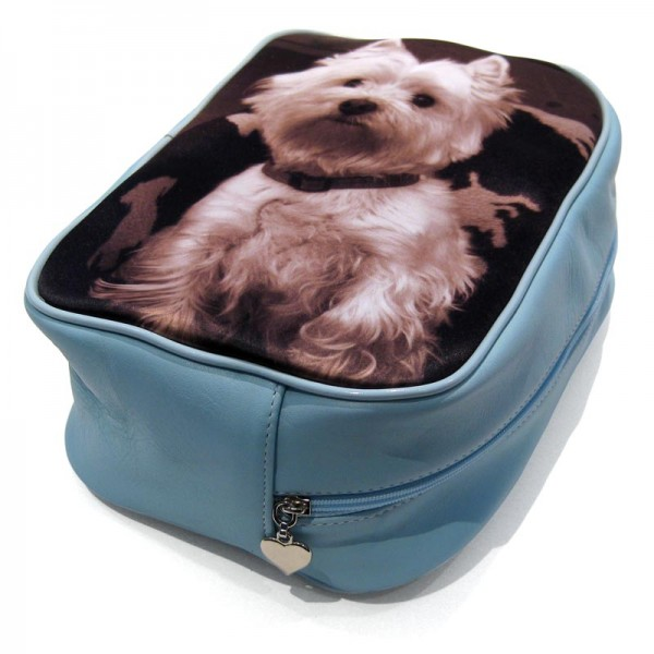 White dog on a baby blue wash bag