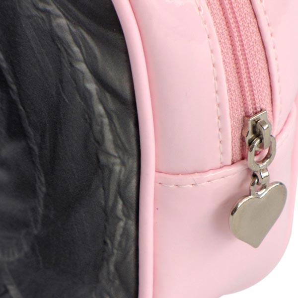 Silver heart on end of zipper on a pink make-up bag