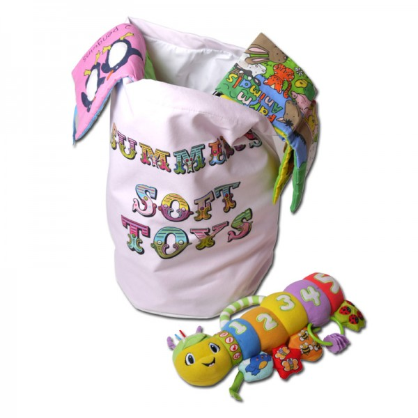 White toy bag with colourful writing on it and toys in it