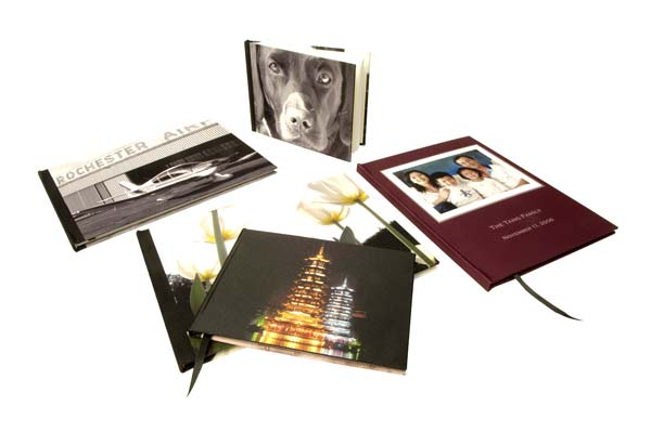 Five photo books with different photos on the covers