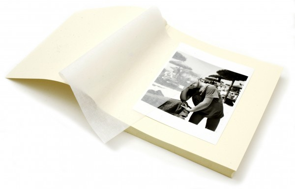 A boy printed on an open photo book