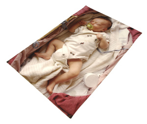 Baby lying in a bed on a blanket