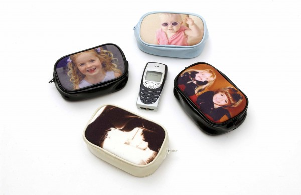 A mobile phone surrounded by four different purses with photos on