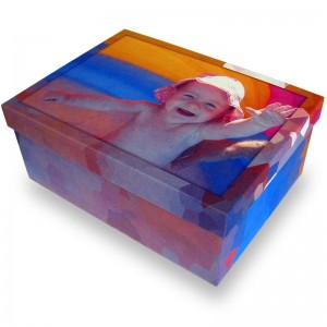 Child on the beach on a box