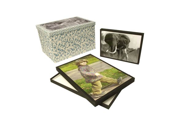 Three boxes of different sizes with photos and patterns