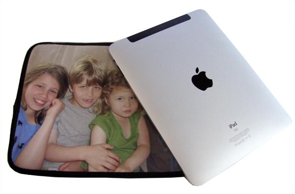 an iPad and an iPad case with children on the cover