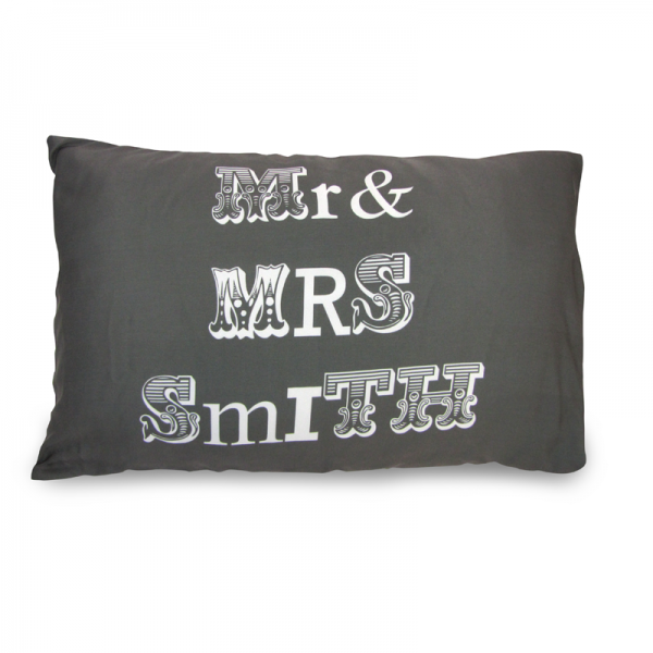 Mr and Mrs Smith written on a grey pillow