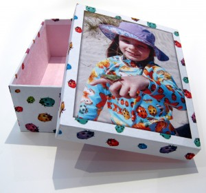 ladybird pattern and a girl on a beach on a box