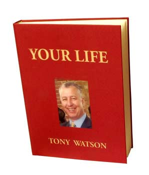 "Red book with a photo of a man and ""your life tony watson"" written on it"