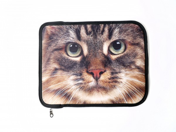 A cat's face on the cover of an iPad case