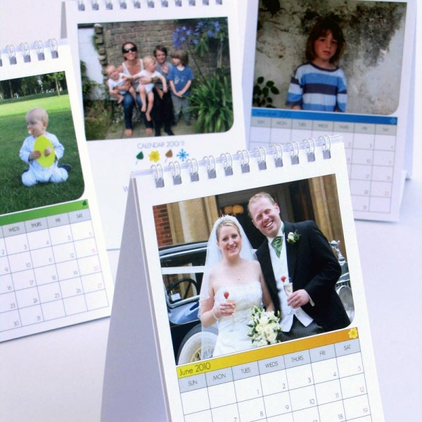 Four A6 size calendars with four different photos