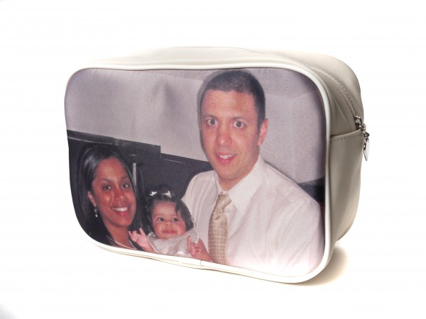 Man, woman and baby on a beige wash bag