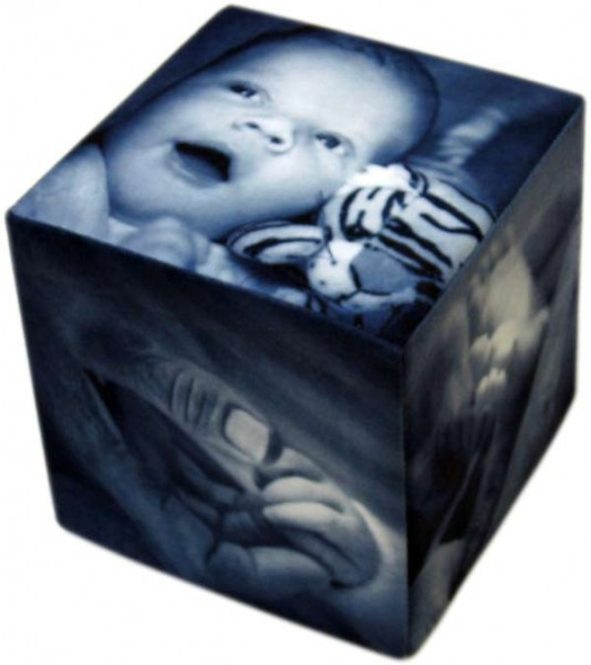Black and white baby photos on a photo cube