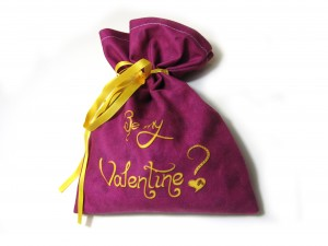 "Purple drawstring pouch with ""be my valentine?"" written on it"