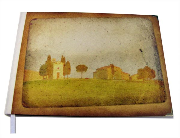 A village landscape image on the cover of a guestbook