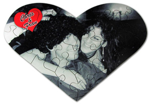 A couple on a heart shaped jigsaw puzzle