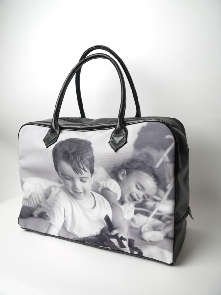 holdall with black and white picture of children
