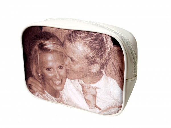 Couple kissing on a beige make-up bag