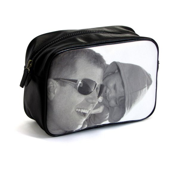 Father and child in black and white on a black washbag