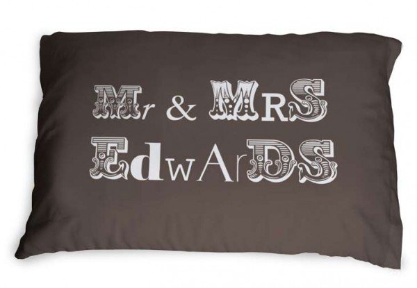 Mr and Mrs Edwards written on a brown pillow