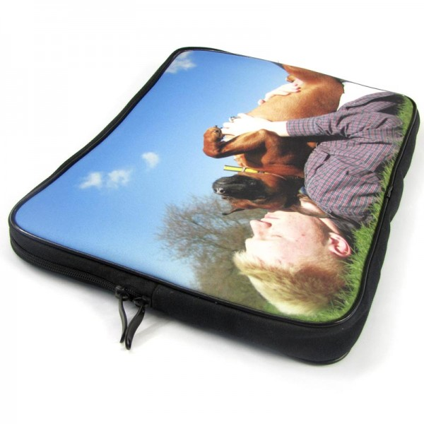 Man holding a dog on the cover of a laptop case